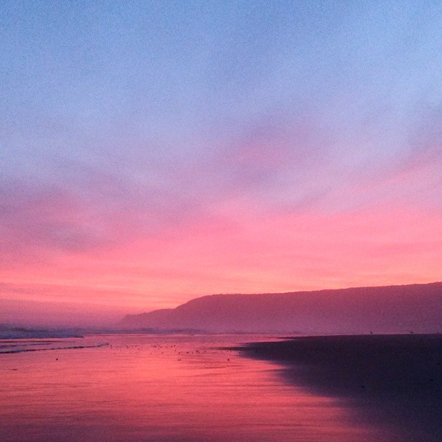 A heavy mist hanging over the whole Valley caused the sunset to flow all around us and bathe the beach in a pink haze. Magical.  #sunset #sky #gardenroute #clouds #colour #reflection